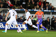 John Stones of Manchester city ® tries to go past Wayne Routledge of Swansea city.  EFL Cup. 3rd round match, Swansea city v Manchester city at the Liberty Stadium in Swansea, South Wales on Wednesday 21st September 2016.<br /> pic by  Andrew Orchard, Andrew Orchard sports photography.