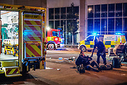 """Incident Response Unit is at the scene supporting a victim after Two Cars crashed at Newham Way (A13) off towards Rathbone Street. A ford Escort flipped over a parked up Mercedes in Canning Town, East London on Saturday, Oct 17, 2020. """"This is a notorious spot for incidents in this area,"""" residents said. All people involved in the incident including children came out okay with a few needing stretchers. """"I saw an Asian lady at her early thirties that was screaming and she was saying that there were two children in the car,"""" a witness told VXP Photographer at the scene. The witness told VXP that the other person who is believed to be the father was also stuck inside. (VXP Photo/ Ehimetalor Unuabona)"""