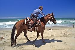 Gerry Ingersoll Riding Horse On Beach
