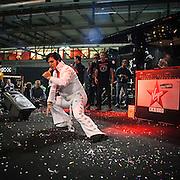 Motosalone Eicma edizione 2012: il sosia di Elvis Presley sul palco di Virgin Radio..International Motorcycle Exhibition 2012: the Elvis Presley sosia on stage of Virgin Radio.