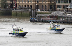© Licensed to London News Pictures. 05/06/2017. London, UK. Two police launches race along the River Thames under London Bridge. The bridge has been opened for the first time today after a terrorist attack on Saturday evening. Three men attacked members of the public after a white van rammed pedestrians on London Bridge. Ten people including the three suspected attackers were killed and 48 injured in the attack. Photo credit: Peter Macdiarmid/LNP