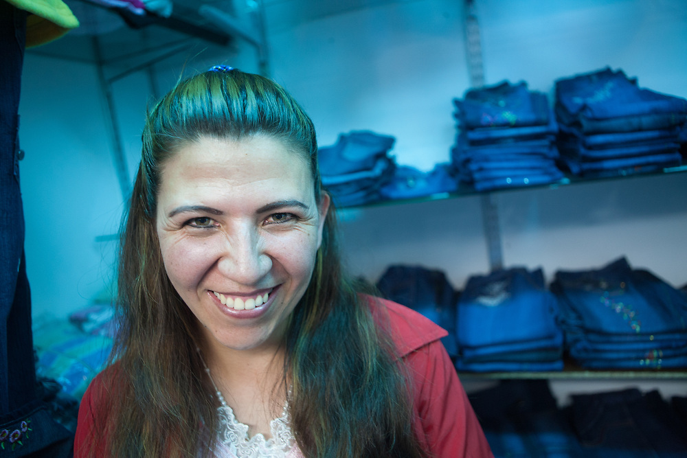A woman sells jeans in the market in Bogotá, Colombia