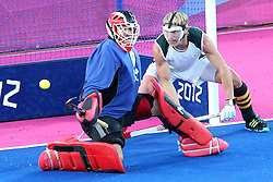 Erasmus Pieterse of South Africa lets one slip by as Spain take the lead during Pool MA Hockey  match between South Africa and Spain held at the Riverbank Arena in Olympic Park in London as part of the London 2012 Olympics on the 3rd August 2012..Photo by Ron Gaunt/SPORTZPICS