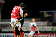 Charlie Raglan (5) of Cheltenham Town Aaron Jarvis (19) of Scunthorpe United battles for possession during the EFL Sky Bet League 2 match between Cheltenham Town and Scunthorpe United at Jonny Rocks Stadium, Cheltenham, England on 20 October 2020.