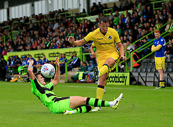 Lee Brown of Bristol Rovers crosses the ball as Jake Gosling of Forest Green Rovers slides in - Mandatory by-line: Paul Roberts/JMP - 22/07/2017 - FOOTBALL - New Lawn Stadium - Nailsworth, England - Forest Green Rovers v Bristol Rovers - Pre-season friendly