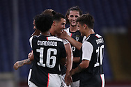 Juventus's Portuguese striker Cristiano Ronaldo celebrates with team mates after scoring to give the side a 2-0 lead during the Serie A match at Luigi Ferraris, Genoa. Picture date: 30th June 2020. Picture credit should read: Jonathan Moscrop/Sportimage