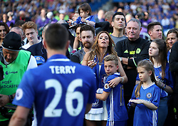 Toni Terry, wife of Chelsea's John Terry watches as he speaks to the crowd after the Premier League match at Stamford Bridge, London.