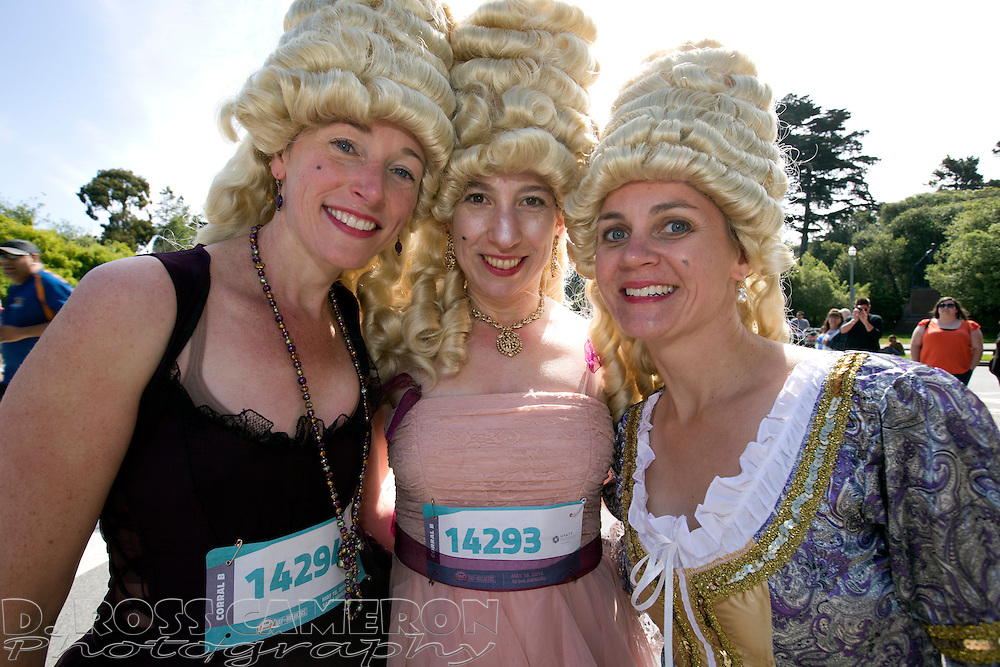 San Franciscans Allyson Ochsner, from left, Lisa Beyer and Marta Storwick, weren't really sure what their costumes were supposed to be, but settled on the popular concensus that they were dressed as Marie Antoinette, the 18th Century queen of France, during the 103rd running of the Bay to Breakers 12K race, Sunday, May 18, 2014 in San Francisco. (Photo by D. Ross Cameron)