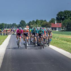 BIDDINGHUIZEN (NED) WIELRENNEN<br /> Zuiderzeeronde eerste wedstrijd Nederlandse Loterij  Clubcompetitie 2021 <br /> Eerste groep in de polder met valpartij in de achtergrond