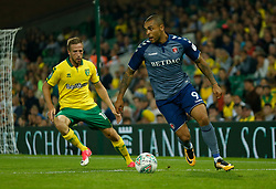 Charlton Athletic's Josh Magennis and Norwich City's Marco Stiepermann battle for the ball