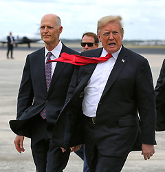 October 8, 2018 - Orlando, Florida, USA - Accompanied by Florida governor Rick Scott, President Trump arrives at Orlando International Airport, Monday, Oct. 8, 2018. Trump delivered remarks to the International Association of Chiefs of Police, at the Orange County Convention Center, in Orlando, Fla. (Credit Image: © Joe Burbank/Orlando Sentinel/TNS via ZUMA Wire)