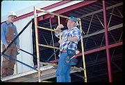 Working on hanger door at Wiley Post Airport