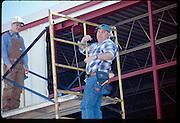 Working on hanger door at Wiley Post Airport