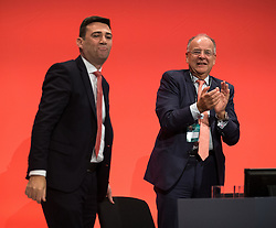 © Licensed to London News Pictures . 30/09/2015 . Brighton , UK . ANDY BURNHAM is applauded by CHARLES FALCONER after Burnham speaks to the conference . The 2015 Labour Party Conference . Photo credit : Joel Goodman/LNP