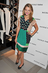 AMBER ATHERTON at a party to celebrate the opening of the new Nicole Farhi global flagship store at 25 Conduit Street, London W1 on 19th September 2011.