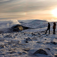 The sun sets above the Cairngorms in this view taken from the summit of Cairn Gorm (1245m) looking towards a cloud shrouded Coire Cas.<br /> Picture by Graeme Hart.<br /> Copyright Perthshire Picture Agency