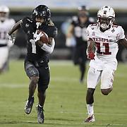 ORLANDO, FL - NOVEMBER 14:  Jaylon Robinson #1 of the Central Florida Knights outruns Linwood Crump #11 of the Temple Owlsat Bounce House-FBC Mortgage Field on November 14, 2020 in Orlando, Florida. (Photo by Alex Menendez/Getty Images) *** Local Caption *** Jaylon Robinson; Linwood Crump