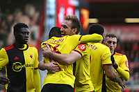 Football - 2019 / 2020 Premier League - AFC Bournemouth vs. Watford<br /> <br /> Abdoulaye Doucoure is congratulated by Craig Dawson of Watford after opening the scoring at the Vitality Stadium (Dean Court) Bournemouth <br /> <br /> COLORSPORT/SHAUN BOGGUST