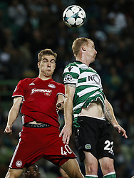 November 22, 2017 - Lisbon, Portugal - Olympiakos's defender Bjorn Engels (L) vies for the ball with Sporting's defender Jeremy Mathieu (R)  during Champions League 2017/18 match between Sporting CP vs Olympiakos Piraeus, in Lisbon, on November 22, 2017. (Credit Image: © Carlos Palma/NurPhoto via ZUMA Press)
