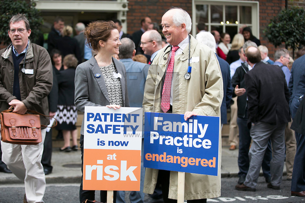 Repro Free: 24/09/2014 Dr Joie Fay and her father Dr Michael Fay are pictured as for the first time in the history of the state, GPs have been motivated to protest as patient safety is now at risk. GPs (as part of NAGP/ National Association of General Practitioners) are pictured protesting outside Leinster House. Picture Andres Poveda
