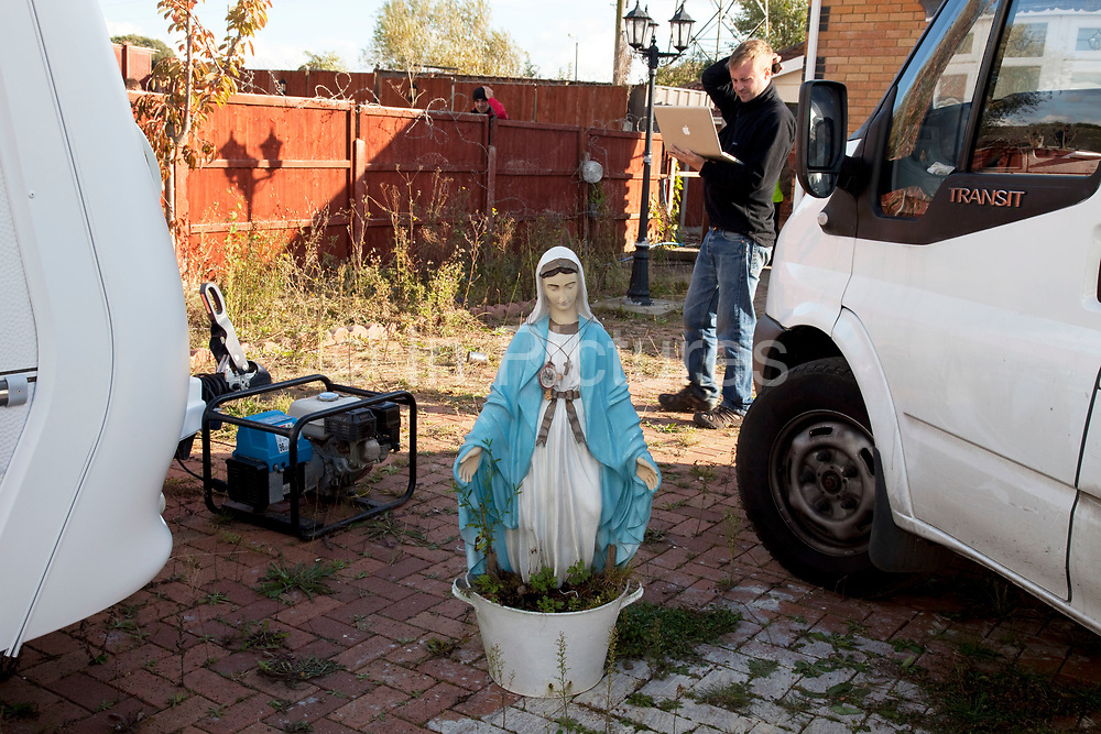Statue of the Virgin Mary on the site. Protesters who barricaded themselves above the entrance to the Dale Farm travellers' site have been removed by police as bailiffs prepare to move in. Essex Police cleared the scaffolding structure so it could be dismantled and machinery driven in by bailiffs to evict the travellers. On Wednesday night Essex Police said that over the course of the day 23 people had been arrested. Clearance of Dale Farm prior to eviction. Riot police and bailiffs were present on 19th October 2011, as a scaffolding gantry was cleared of protesters so the site could be cleared. Dale Farm is part of a Romany Gypsy and Irish Traveller site on Oak Lane in Crays Hill, Essex, United Kingdom. Dale Farm housed over 1,000 people, the largest Traveller concentration in the UK. The whole of the site is owned by residents and is located within the Green Belt. It is in two parts: in one, residents constructed buildings with planning permission to do so; in the other, residents were refused planning permission due to the green belt policy, and built on the site anyway.