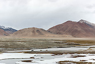 Horses moving away from an incoming storm near Tso Kar, Ladakh