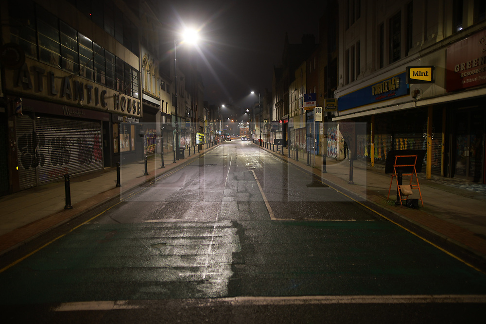 © Licensed to London News Pictures . 31/12/2020. Manchester, UK. Oldham Street in the Northern Quarter , which has been packed with revelers in previous years, is seen with no people . The streets of Manchester stand empty overnight (31st December 2020 to 1st January 2021) as Manchester enters the New Year under tier 4 of the government's Coronavirus lockdown . Photo credit: Joel Goodman/LNP