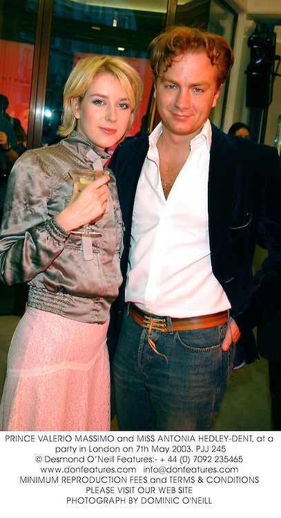 PRINCE VALERIO MASSIMO and MISS ANTONIA HEDLEY-DENT, at a party in London on 7th May 2003.PJJ 245