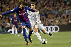 May 6, 2018 - Barcelona, Catalonia, Spain - Gerard Pique vies with Cristiano Ronaldo during the spanish football league La Liga match between FC Barcelona and Real Madrid at the Camp Nou Stadium in Barcelona, Catalonia, Spain on May 6, 2018  (Credit Image: © Miquel Llop/NurPhoto via ZUMA Press)