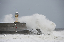 © Licensed to London News Pictures. 23/03/2013..Cleveland, England..Big waves smash against the sea wall at South Gare on Teesside as the wintery weather continues to chill the country. Cleveland on the east coast of England suffered freezing cold and strong winds that brought big seas to the coastline...Photo credit : Ian Forsyth/LNP
