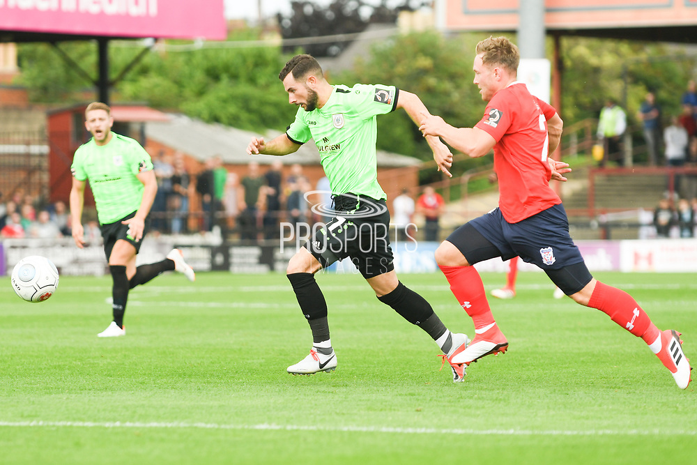 Connor Hughes of Curzon Ashton (11) drives towards the box with the ball during the Vanarama National League North match between York City and Curzon Ashton at Bootham Crescent, York, England on 18 August 2018.