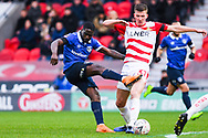 Christopher Missilou of Oldham Athletic (17) shoots whilst blocked by Paul Downing of Doncaster Rovers (31) during the The FA Cup fourth round match between Doncaster Rovers and Oldham Athletic at the Keepmoat Stadium, Doncaster, England on 26 January 2019.