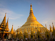 Tourists at the Shwedagon Pagoda Complex, Yangon (Rangoon). It is the most sacred Buddhist Stupa in Myanmar and one of the most important religious reliquary monuments in the world