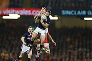 Tommy Seymour of Scotland jumps for a high ball with Liam Williams of Wales.  RBS Six nations championship 2016, Wales v Scotland at the Principality Stadium in Cardiff, South Wales on Saturday 13th February 2016. <br /> pic by  Andrew Orchard, Andrew Orchard sports photography.