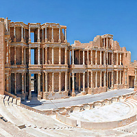 Sabratha. Libya. View of the magnificent Roman theatre which originally dates from 175-200 AD and in its heyday could seat over 5000 spectators.  One of the most graceful and impressive of the Roman world, the theatre's imposing stage towers three storeys high and consists of 108 fluted Corinthian columns.