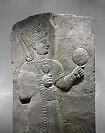 Hittite relief sculpted orthostat stone panel of Long Wall Basalt, Karkamıs, (Kargamıs), Carchemish (Karkemish), 900 - 700 B.C. Anatolian Civilizations Museum, Ankara, Turkey.<br /> <br /> Goddess Kubaba. Goddess is depicted from the profile. The part below the chest of the relief is broken. She holds a pomegranate in her hands on her chest. She carries a one-horned headdress on her head. Her braided hair hangs down to her shoulder. The text in the hieroglyphics is not understood. The lower part of the relief has been restored. <br /> <br /> On a grey art background. .<br />  <br /> If you prefer to buy from our ALAMY STOCK LIBRARY page at https://www.alamy.com/portfolio/paul-williams-funkystock/hittite-art-antiquities.html  - Type  Karkamıs in LOWER SEARCH WITHIN GALLERY box. Refine search by adding background colour, place, museum etc.<br /> <br /> Visit our HITTITE PHOTO COLLECTIONS for more photos to download or buy as wall art prints https://funkystock.photoshelter.com/gallery-collection/The-Hittites-Art-Artefacts-Antiquities-Historic-Sites-Pictures-Images-of/C0000NUBSMhSc3Oo