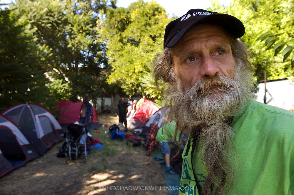 """John Kraintz, 55, a homeless leader looks over a """"safe ground"""" location on C St. that about 30 homeless moved to on August 21, 2009."""