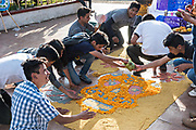 Students work on an ofrenda or altar for the Day of the Dead festival in the town plaza in Opopeo, Michoacan, Mexico.