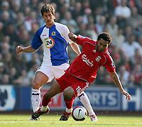 Photo: Paul Thomas.<br /> Liverpool v Blackburn Rovers. The Barclays Premiership. 14/10/2006.<br /> <br /> Morten Gamst Pedersen (L) of Blackburn fouls Jermaine Pennant.