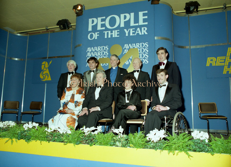 People Of The Year Awards..1986..24.11.1986..11.24.1986..24th November 1986..The 1986 People of the Year Awards,sponsored by New Ireland Assurance and the Rehabilitation Institute,were presented by An Taoiseach,Dr Garrett Fitzgerald at the Burlington Hotel,Dublin..Picture of the award winners with An Taoiseach,Dr Garret Fitzgerald,(centre-front row).(front row)L-R.,Dr Susan McKenna-Lawlor,Ms Garry Hynes and Mr Cathal McDonagh..(back row)L-R. Mr William Houlihan, Mr Neil Jordan,Rev Cecil Kerr,Mr Jonjo O'Neill and Mr Denis Brosnan