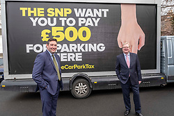 Pictured: <br />Today the Scottish Conservatives launched an advertising campaign against the Car Park Tax, with the SNP and the Greens set to vote it through Holyrood. Jackson Carlaw MSP and Miles Briggs MSP unveiled an Ad Van at Letham Park Care Home Edinburgh before it travels across the central belt to workplaces that are set to be hit by the parking charge.<br /><br />Ger Harley | EEm 21 February 2019