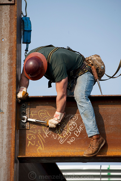 "Ironworker Jeff Devine tightens bolts on an I beam at his fiftieth floor worksite in Chicago.   (From the book What I Eat: Around the World in 80 Diets.) The caloric value of his typical day's worth of food on a day in the month of September was 6,600 kcals. He is 39; 6'1"" and 235 pounds. He carries a cooler of ready-to-eat food from home rather than eat at fastfood restaurants and vending trucks. At right: Jeff tightens the bolts on an I beam."