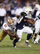 San Diego Chargers running back Gus Johnson (33) tries to break a tackle attempt by San Francisco 49ers defensive end B.J. McBryde (60) runs the ball during the 2016 NFL preseason football game against the San Francisco 49ers on Thursday, Sept. 1, 2016 in San Diego. The 49ers won the game 31-21. (©Paul Anthony Spinelli)