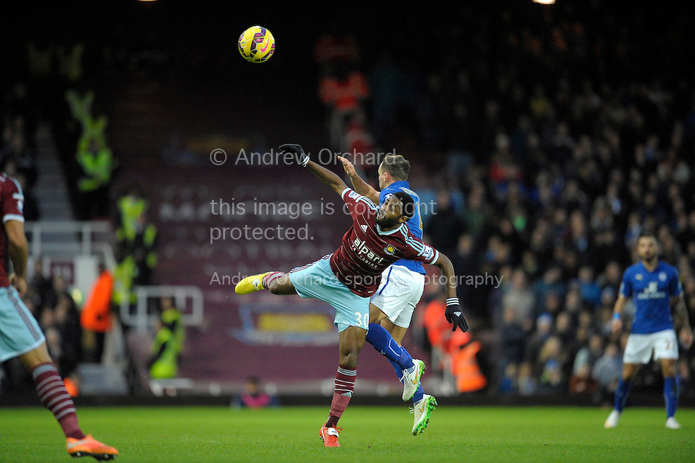 Alex Song of West Ham United compteting with Daniel Drinkwater of Leicester City. Barclays Premier league match, West Ham Utd v Leicester city at the Boleyn ground, Upton Park in London on Sat 20th December 2014.<br /> pic by John Patrick Fletcher, Andrew Orchard sports photography.