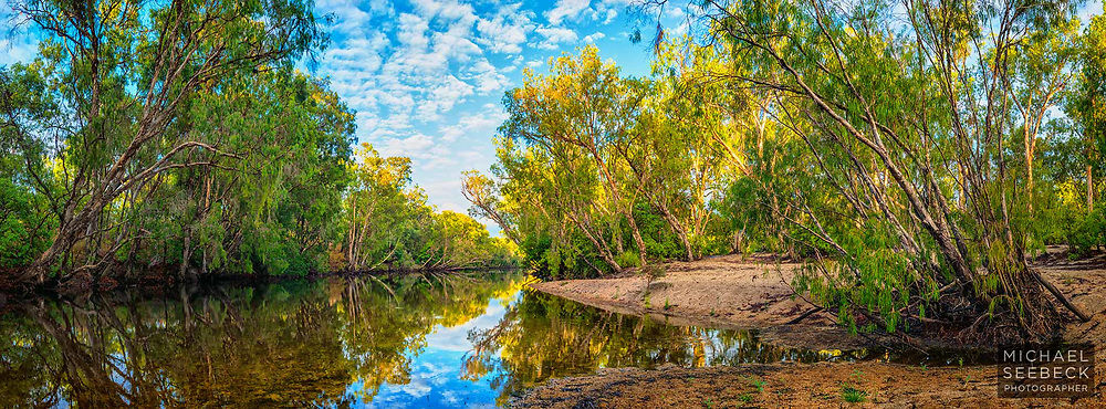 A still waterhole on a wild river in Cape York Peninsula, captured in early morning sunlight.<br /> <br /> Code: AAQP0001<br /> <br /> Limited Edition of 125 Prints