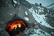 Kyrgyz men seek shelter in a shepherd's cave during the icy five-day trek down from their mountainous homeland to the nearest trading village in Afghanistan. They will barter livestock, wool, and dairy products for everything from tea to television sets...