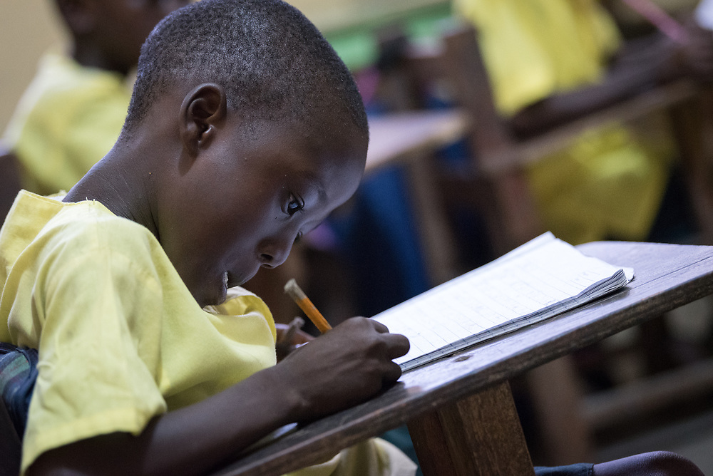 4 November 2019, Monrovia, Liberia: A young student practices writing in the library of Saint Peter's Lutheran School in Monrovia.