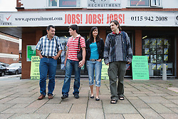 Group of Eastern European people outside a recruitment agency,