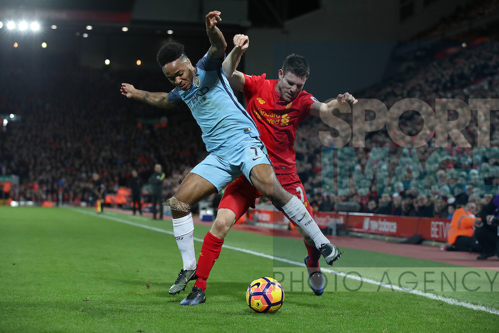 Raheem Sterling of Manchester City and James Milner of Liverpool during the English Premier League match at Anfield Stadium, Liverpool. Picture date: December 31st, 2016. Photo credit should read: Lynne Cameron/Sportimage