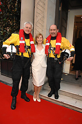 Left to right, RNLI lifeboat man DAVID FERGUSON, VAL AISHER she was chairman of the evening, and RNLI Lifeboat man STEPHEN WHEATLEY at a fund raising evening in aid of the Royal National Lifeboat Institution at Garrard, 24 Albemarle Street, London W1 on 23rd April 2008.<br />